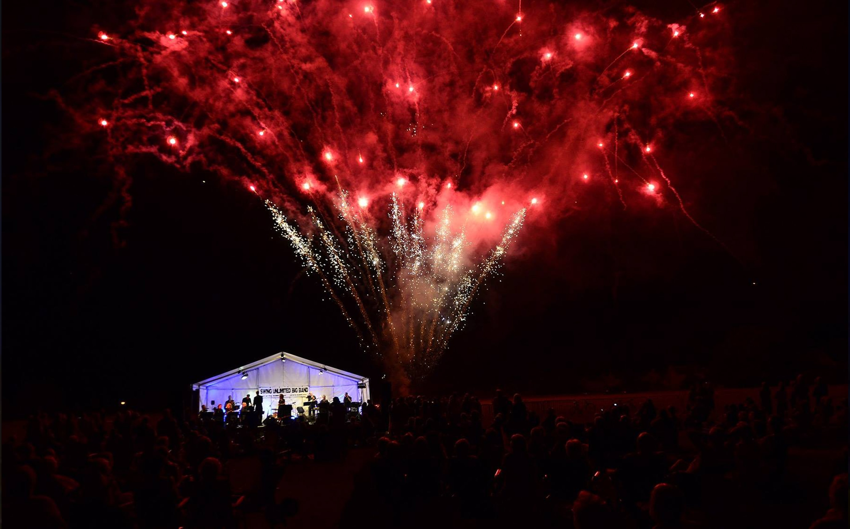 A Firework Solutions Limited display, a large scale wedding display with bright red fireworks