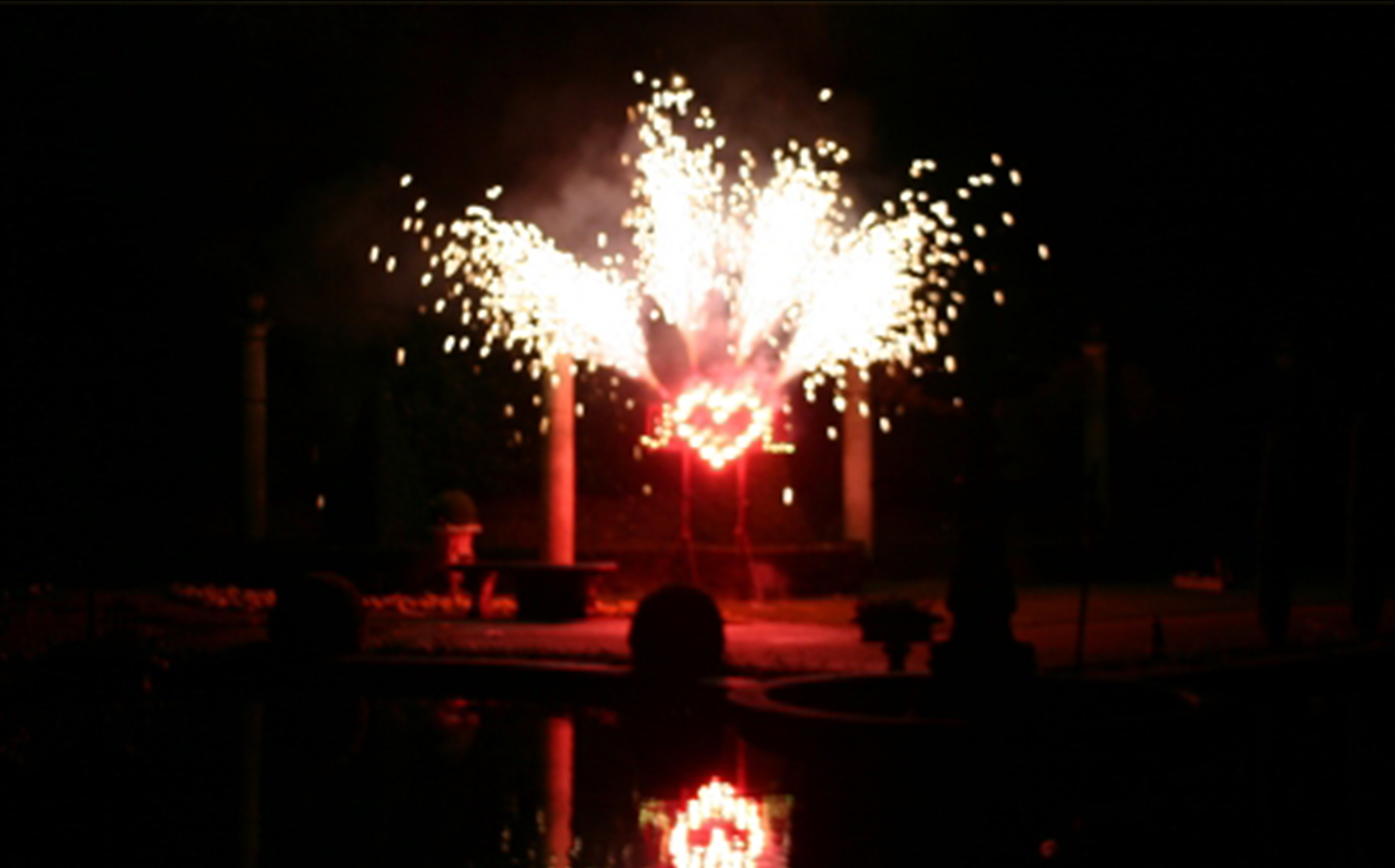 A Firework Solutions Limited wedding display, featuring a red heart for the happy couple